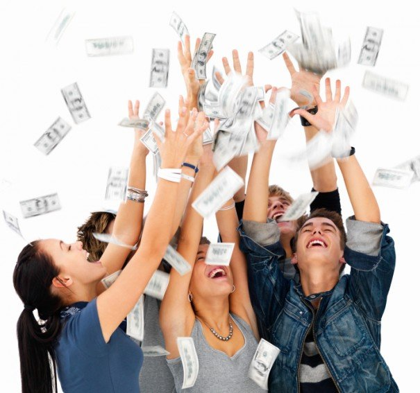 Young men and women playing with money agai9nst white background