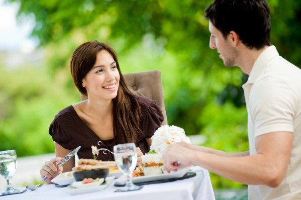 woman and man talking dinner relationship questions to ask