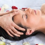 Brunette getting a head massage in the spa salon