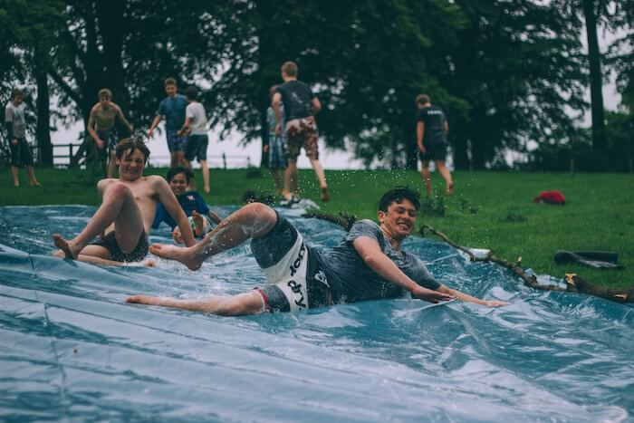 boys slip and slide having fun