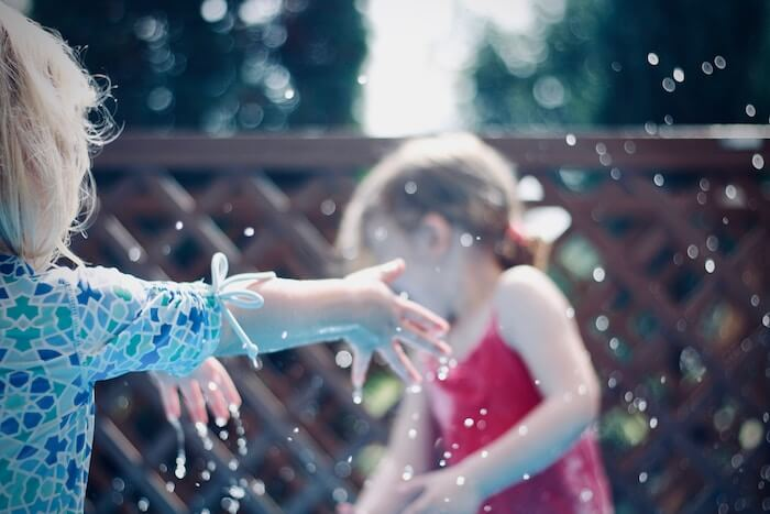 girls playing in water having fun