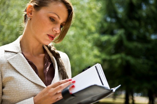 Businesswoman reading notes
