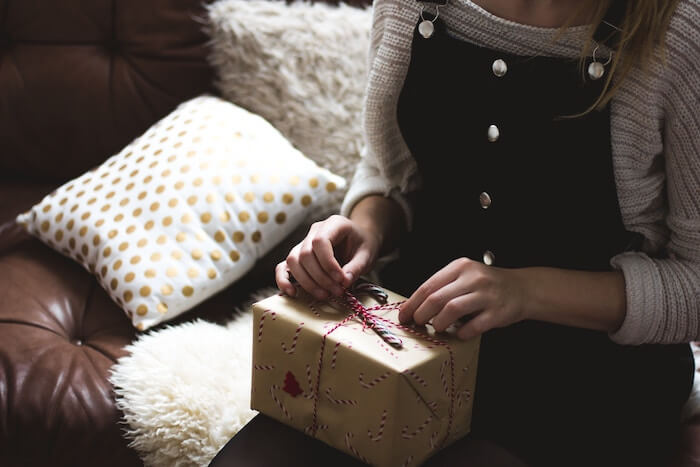 woman hold present meaningful gifts