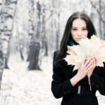 Brunette woman with maple leaves