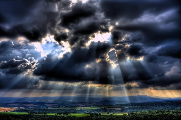 sun through clouds photo