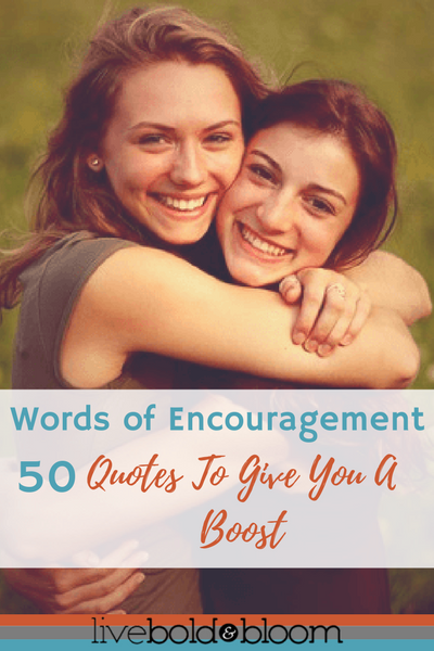 women hugging smiling words of encouragement