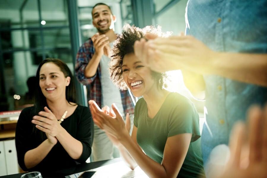 group applauding success growth mindset
