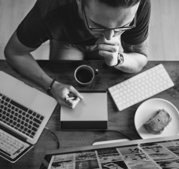 man focused at computer desk growth mindset
