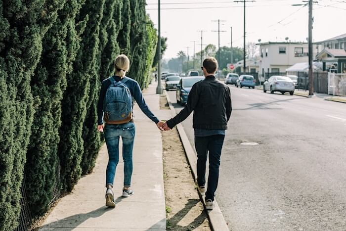 couple walking street relationship problems