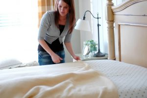 woman making bed, keystone habits