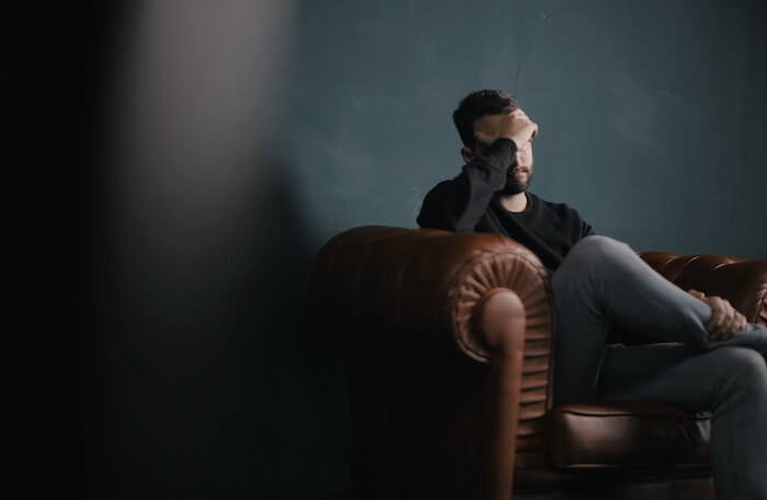 sad man sitting on sofa relationship problems