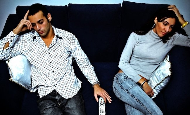 couple-on-sofa signs of emotional-abuse