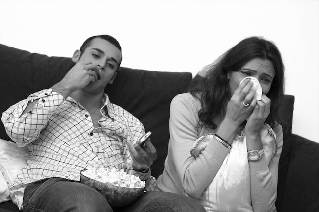 couple sitting woman crying signs of emotional abuse