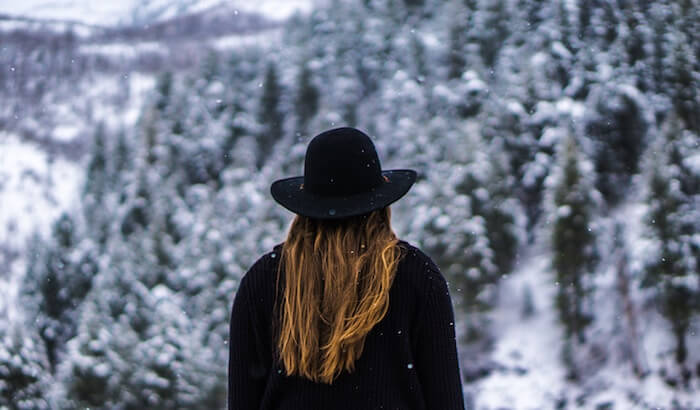 woman outside in snow alone deep questions to ask yourself
