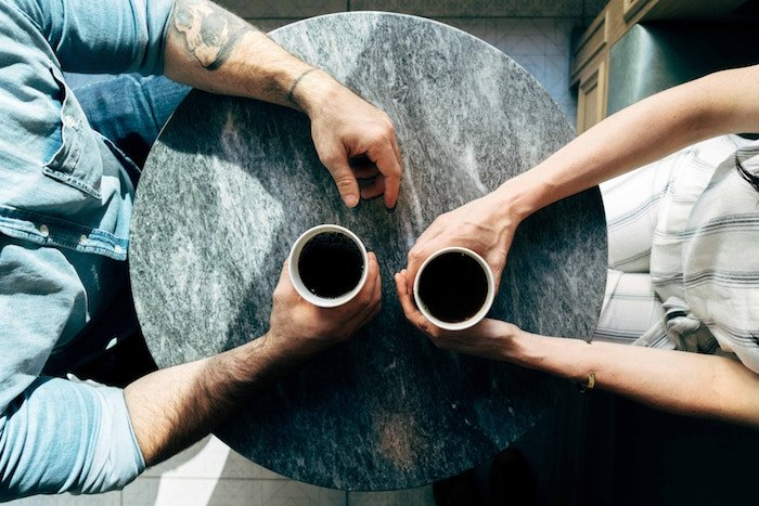 man and woman having coffee conversation starters