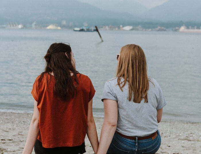 two women talking beside ocean how to tell someone you like them