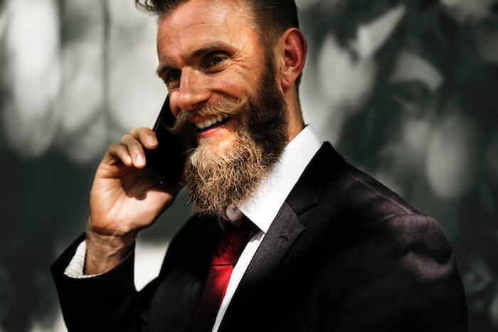 man with beard talking on phone Long Distance Relationship