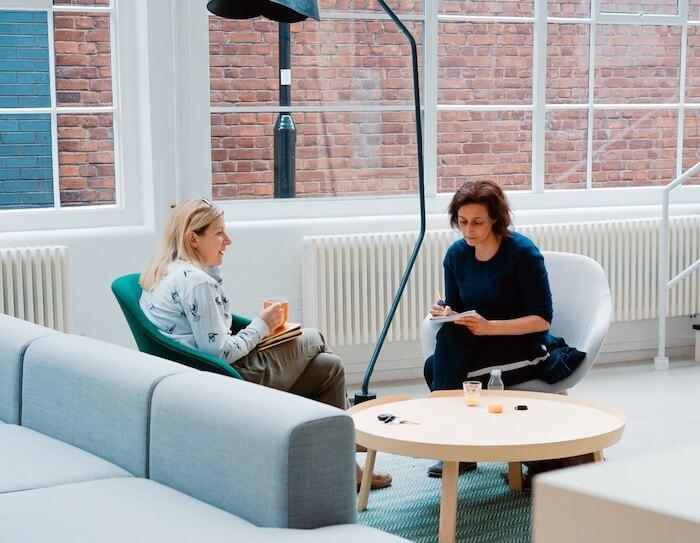 women sitting talking constructive criticism