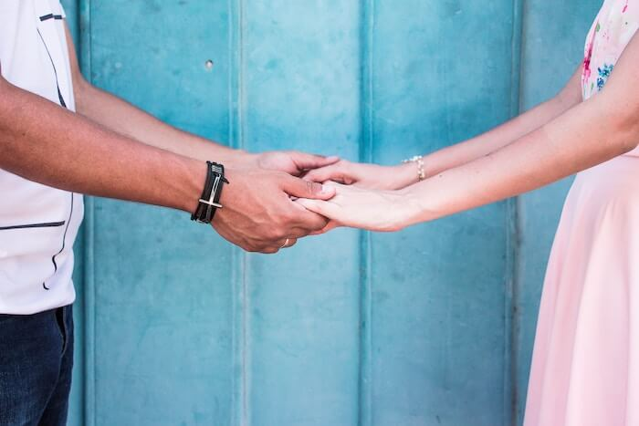 couple facing each other holding hands how to rebuild trust