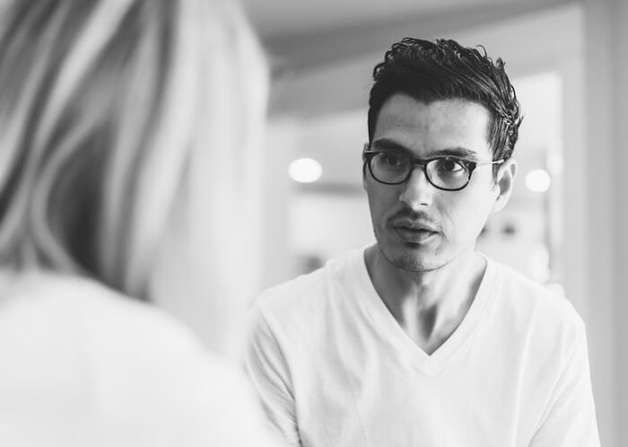 man talking to woman how to rebuild trust