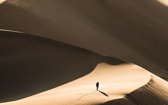 person alone in sand dunes how to find yourself