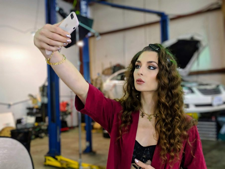 woman taking selfie, self-absorbed person
