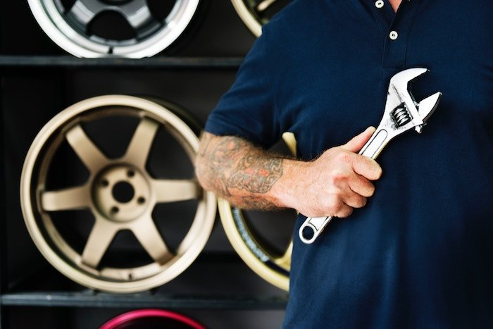 man in garage with wrench jobs for people with anxiety