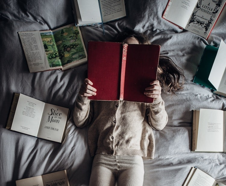 Girl reading books bed personal development