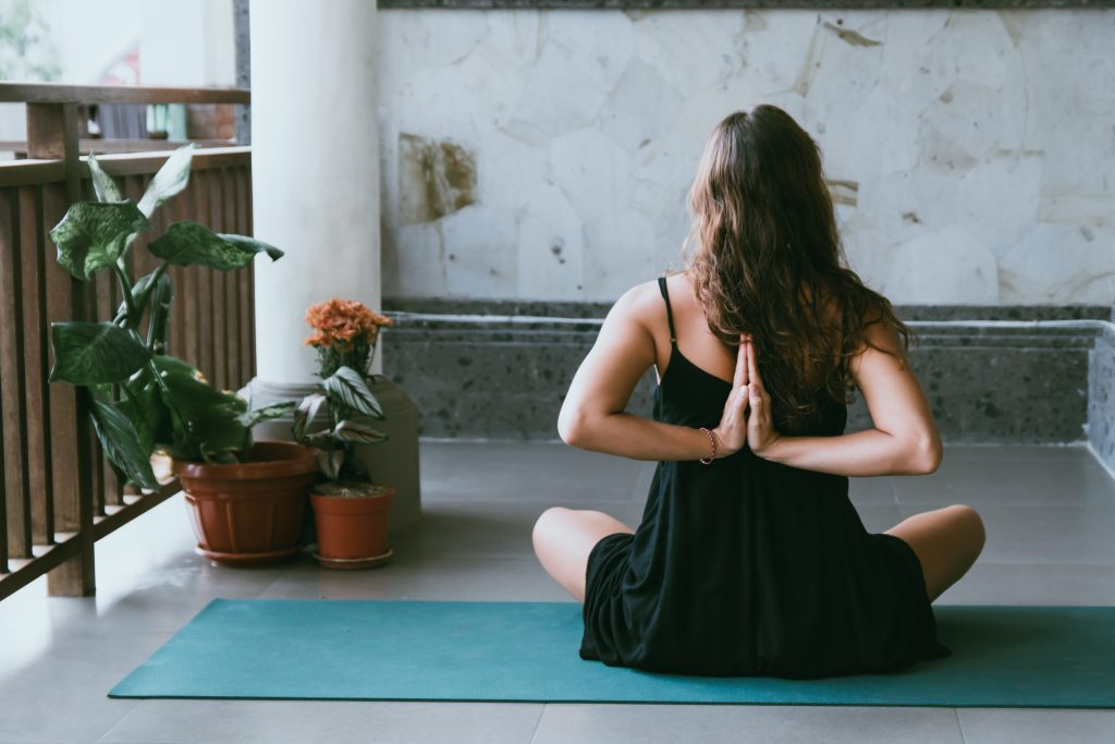 woman doing yoga, things to do when bored