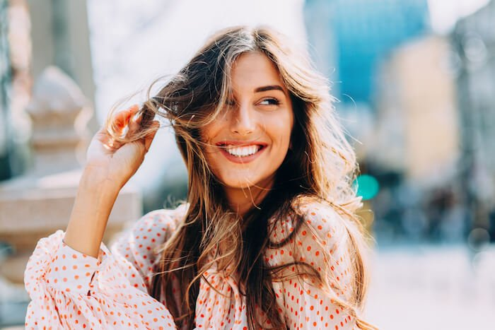 Happy woman outside how to love yourself