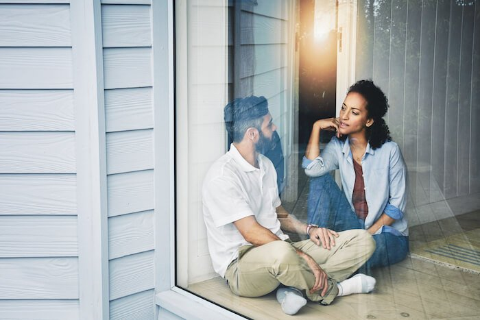 couple talking on porch getting to know you questions