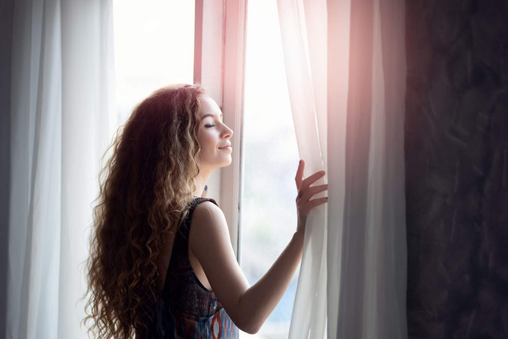 woman at window, how to be happy again
