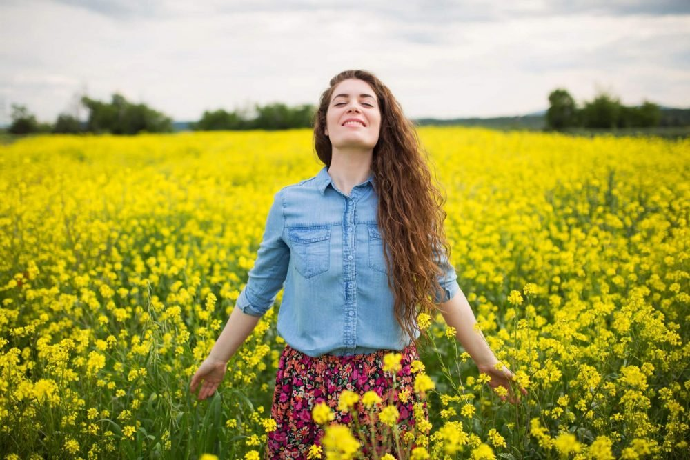 woman in flower field, affirmations for women