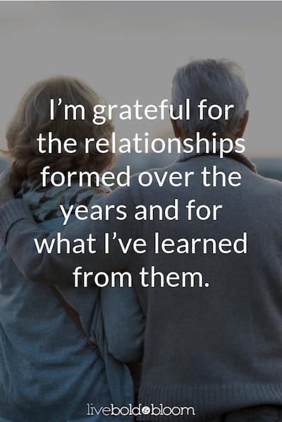 couple sitting gratitude journal