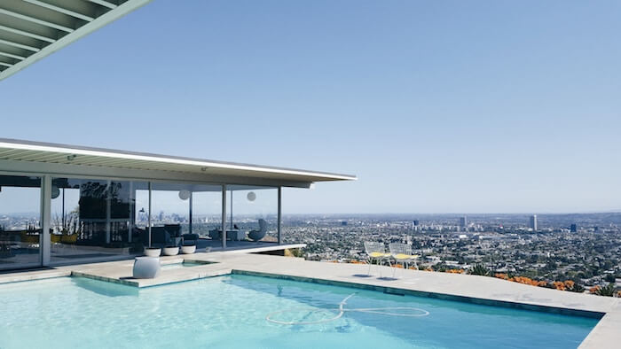 modern house overlooking city money quotes