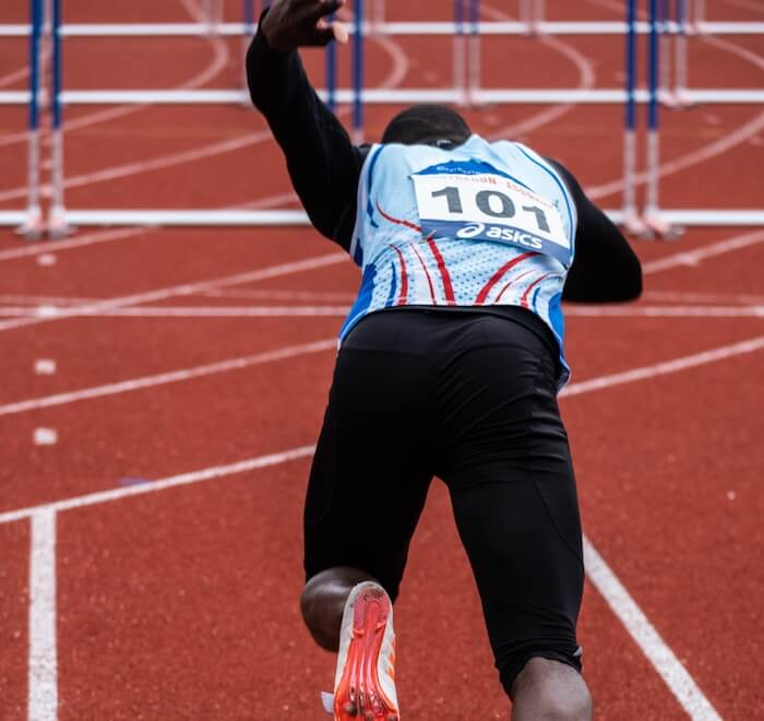 runner hurdles overcoming obstacles