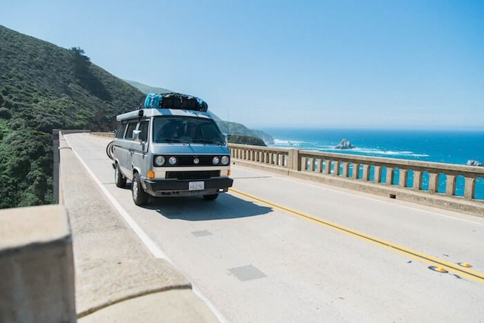 volkswagen camper on highway ocean money quotes