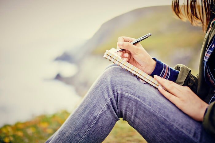 woman-writing-in-diary-sitting journaling ideas