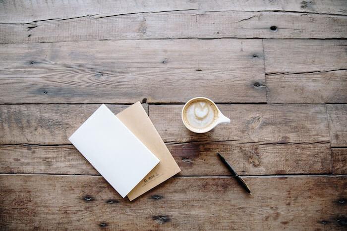 journal and coffee mug on table Gratitude Journal