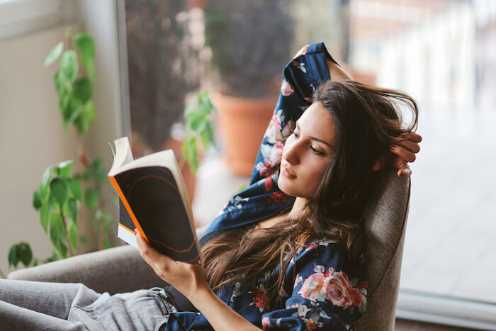 Woman reading at home life goals