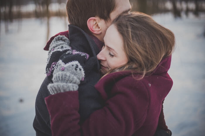 couple hugging in snow date ideas