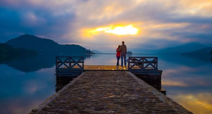 couple watching sunset on dock date ideas