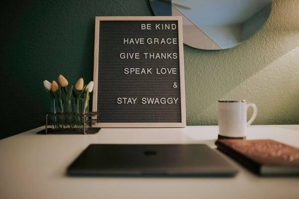 sign on desk, mottos to live by