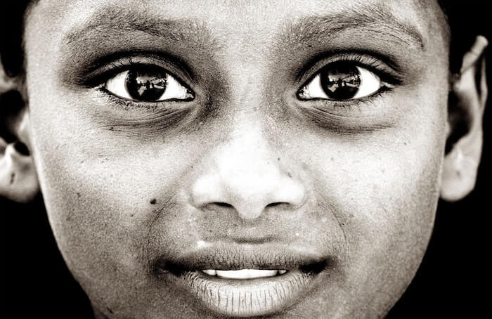 close up of woman's face black and white mottos to live by
