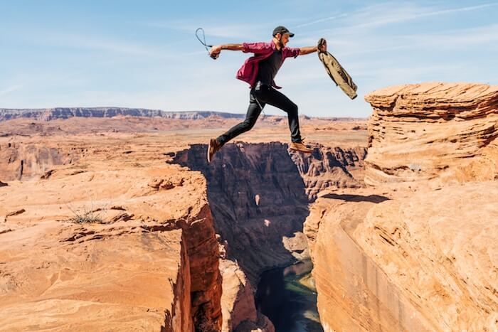 man jumping over canyon motivation monday quotes