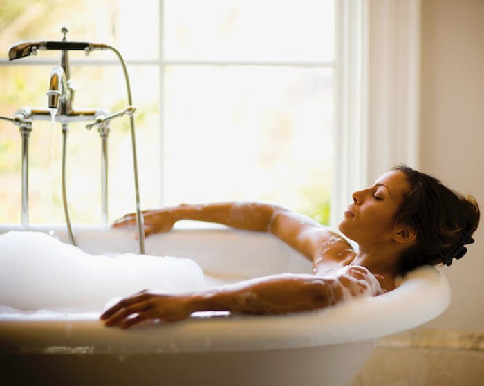 woman in bubble bath how to let go of anger