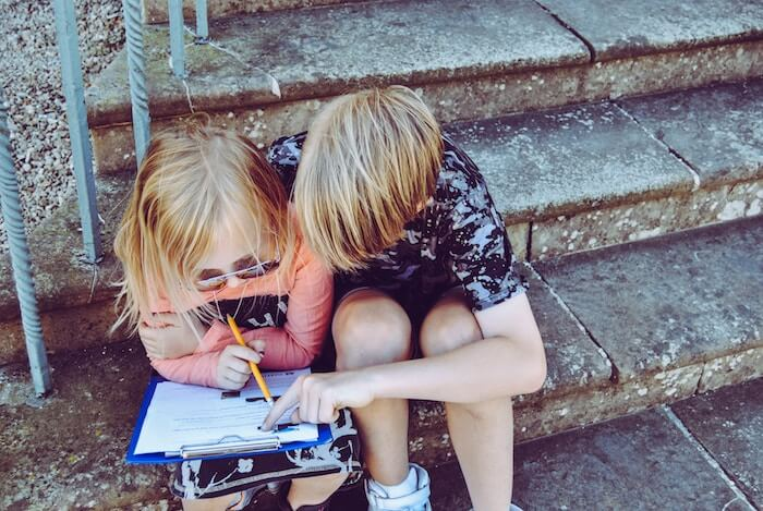 young students doing homework how to be a nicer person