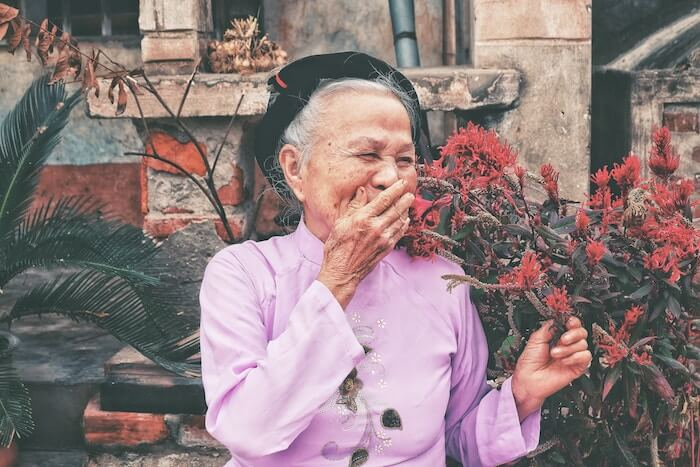 chinese woman smelling flowers Things To Be Grateful For