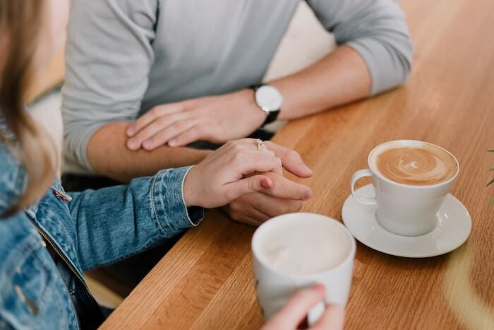 couple holding hands with coffee how to build trust