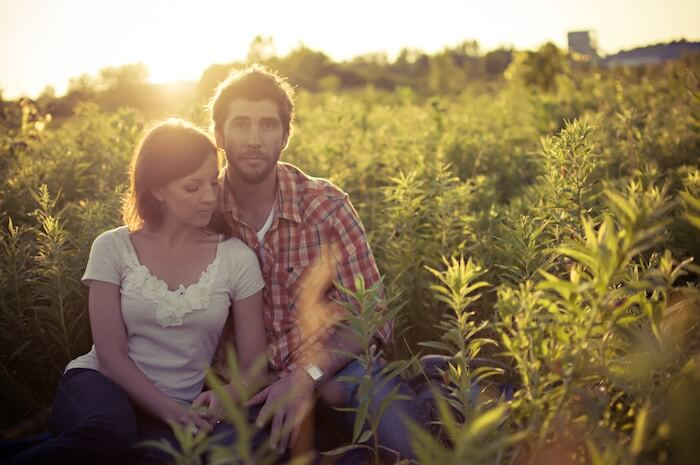 couple sitting in field of flowers Relationship Quizzes